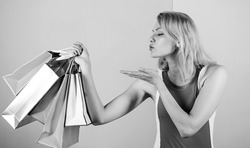 love shopping. happy woman shopper. big sale. female shopaholic hold shopping bags. present packages for holiday preparation. summer discount. special offer on black friday. shop closeout.