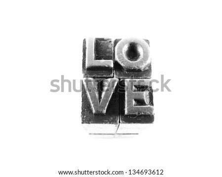 Love sign,  antique metal letter-press type isolated
