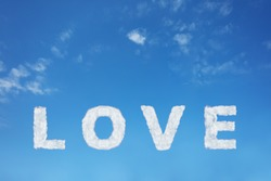 Love sign made of clouds letters over clear day blue sky