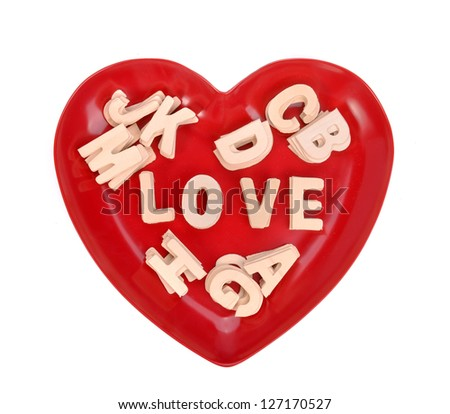 Love Spell With Wooden Alphabet Blocks On Heart Shape Plate Stock ...