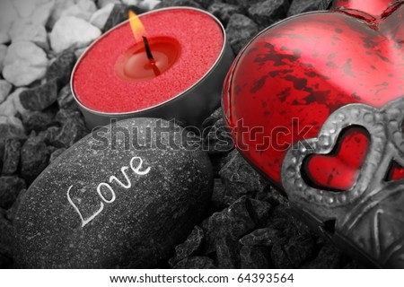 love still life with heart cabdle and a love stone
