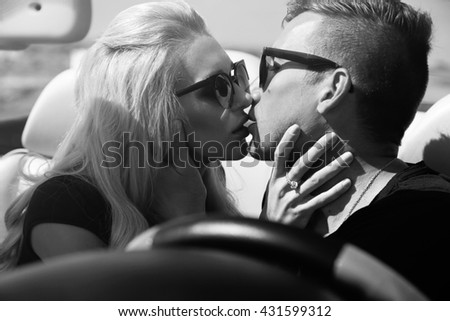 love story. fashion outdoor photo of impassioned couple in casual clothes, posing beside luxurious car  #431599312