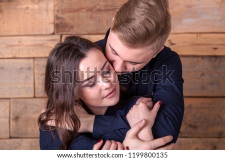 love story. Gentle kiss of young lovers, a young guy gently hugs his girlfriend   #1199800135