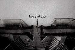 love story typed words on a vintage typewriter