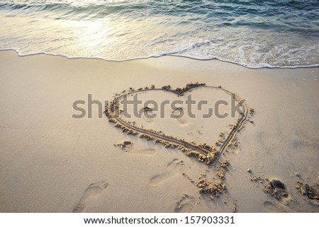 Love symbol. Heart written on sand of a beautiful beach in Emirates.