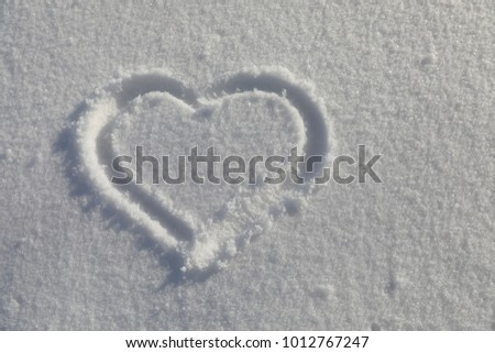 Love symbol on snow #1012767247