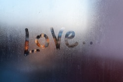 Love - the inscription on the frosty window.