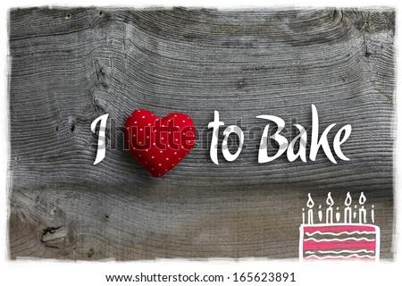 Love to bake message handmade decoration polka dot fabric hearth over rustic Elm wood background - retro style design