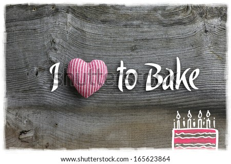 Love to bake message  handmade decoration red stripes fabric hearth over rustic Elm wood background - retro style design