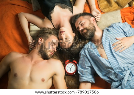 Love triangle and romance, perfect morning. men and woman with long hair, lover. Swinger relations, relax, wake up. Family trust, polygamy, betrayal. people lovers sleep at alarm clock, time. friends #789017506