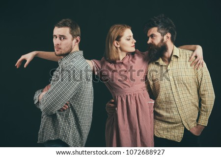 Love triangle concept. Relations, communication, friendship, love, betrayal. Men, woman on pensive faces, black background. Men in checkered clothes, retro style. Company of confident people, friends.