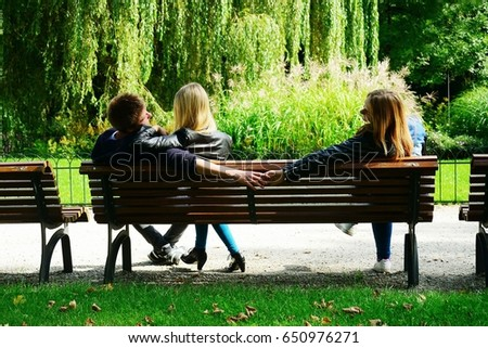 Love triangle in Vilnius town Bernardinu garden on autumn. Lithuania. #650976271