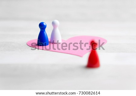 Love triangle or being third wheel. Having affair, infidelity or cheating concept. Board game pawns and paper heart on table.  #730082614