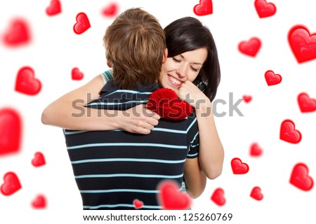 love valentine day couple, young woman hug man holding red heart, happy love couple, smile attractive girl closed eyes, isolated over white background, valentine day concept hearts flying around - stock photo