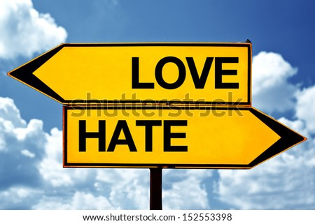 Love versus hate, opposite direction signs as concept of choices we make in life