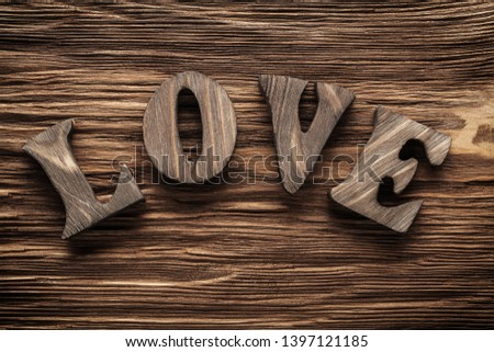 love vintage wood letters on wooden background