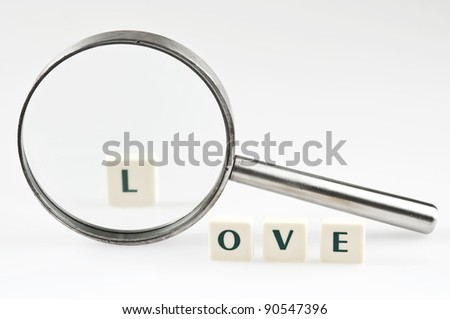 Love word and magnifying glass
