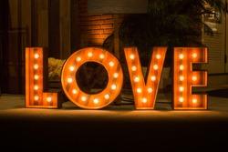 Love word with glowing light bulbs