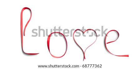 Love word written in red ribbon