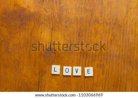 love written in letter tiles #1103066969