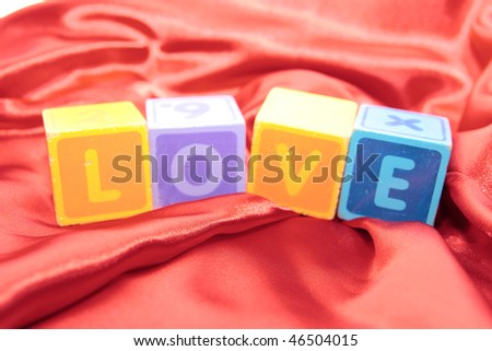 love written with blocks on a silk nightie