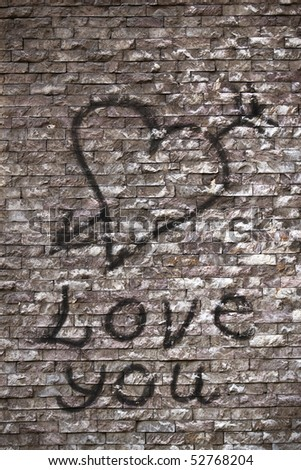 stock photo : Love you and a heart graffiti on the wall