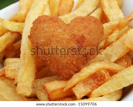 Love your food, deep fried scampi in the shape of a heart with french fries
