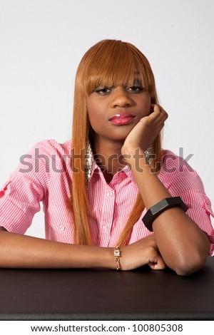 Lovely African American woman thinking seriously with her chin on her hands
