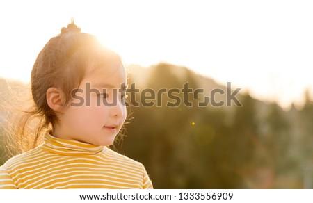 Lovely Asian girl in the sunshine #1333556909