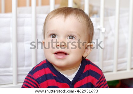 lovely baby boy age of 1 year against white bed #462931693