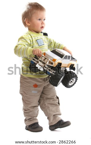 Lovely Baby Boy playing with toy monster truck shot in studio - stock photo