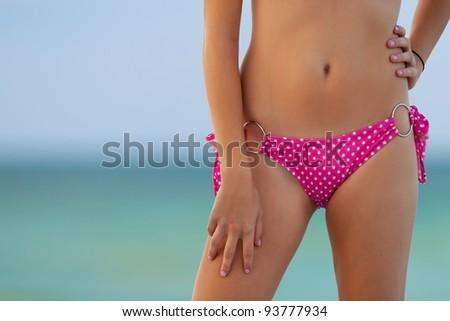 lovely bikini model torso against turquoise gulf water in key west