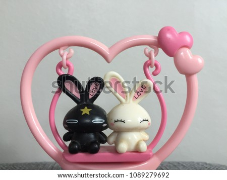 Lovely black and white rabbits lovers cartoon. #1089279692