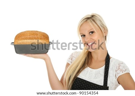 Lovely blond baker woman with a freshly baked loaf of bread