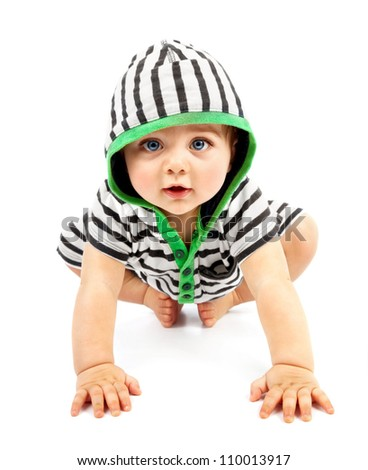 Lovely boy isolated on white background, sweet little baby wearing striped sliders, charming small kid in black & white hoodie with biggin crawling indoors, happy childhood conception