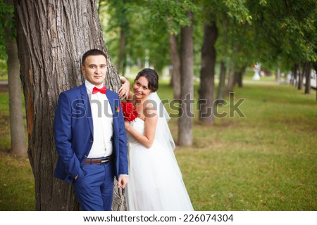 Lovely bridal couple in the forest lovely day