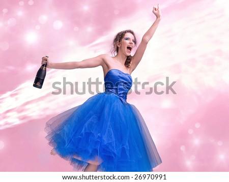 Lovely brunette in blue dress holding bottle of wine