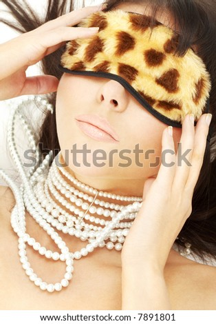 lovely brunette with pearls in leopard mask