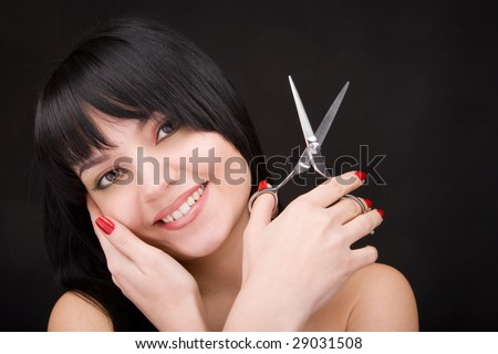 Lovely brunette with scissors of the hairdresser
