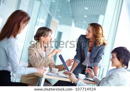 Lovely business ladies gathered for a brainstorm
