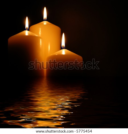 lovely candles with perfect flames in rendered water