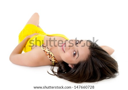 Lovely caucasian woman in yellow dress laying down on white
