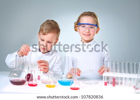 Lovely children doing homework experimenting with substances and samples