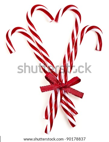 lovely christmas candy cane in heart form isolated on white