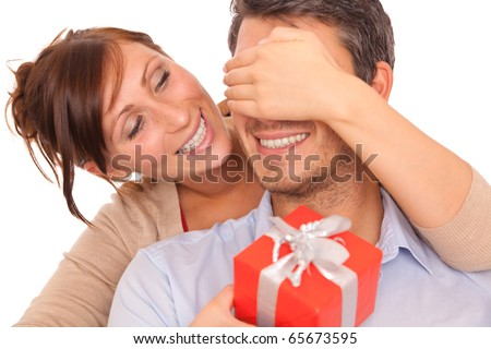 Lovely christmas couple holding presents - stock photo