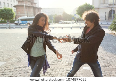 Lovely couple dancing West Coast Swing in the streets, carefree and happy. #1074897032
