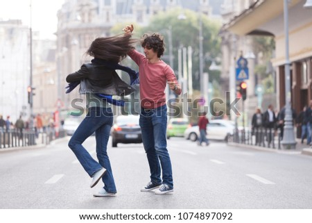 Lovely couple dancing West Coast Swing in the streets, carefree and happy. #1074897092