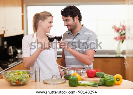 Lovely couple drinking a glass of wine in their kitchen