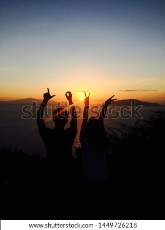 Lovely couple enjoying the sunset. #1449726218