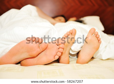 Lovely couple in bed, focus on feet